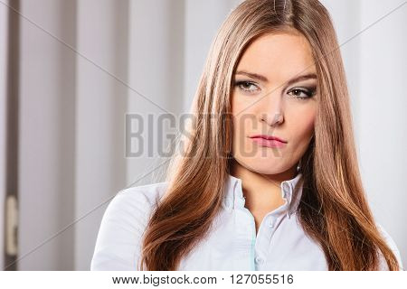 Stress and emotions in business. Professional woman in uniform work in office unhappy and nervous
