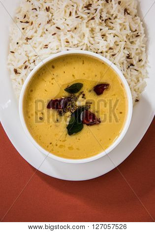 Whole Yellow Lentil with Rice, dal tadka and jeera rice, Indian Dish, cooked rice and cooked Arhar or Toor dal (Pigeon Pea) ** Note: Soft Focus at 100%, best at smaller sizes