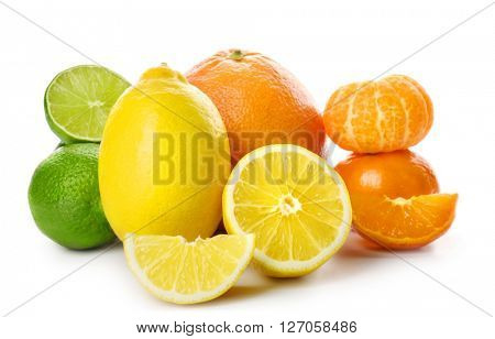 Mixed citrus fruit including lemons, grapefruit, tangerines and limes isolated on a white background, close up