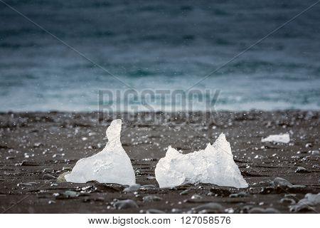 Icebergs on the shore of Jokulsarlon glacier lagoon ** Note: Shallow depth of field