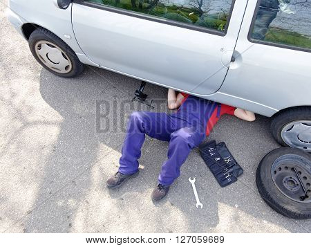 Mechanic repairing a car vehicle breakdown outdoor ** Note: Visible grain at 100%, best at smaller sizes