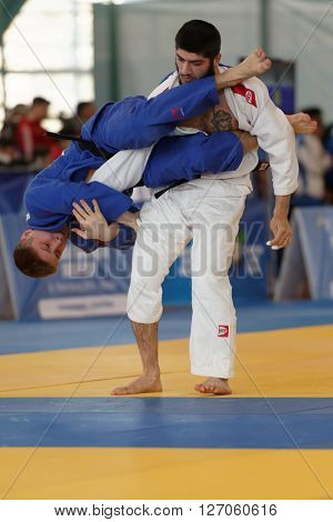 ST. PETERSBURG, RUSSIA - APRIL 16, 2016: Fight  Giorgi Khmelidze of Georgia (white) vs Aleksandr Kupershmit of Russia during the Junior European Judo Cup. 346 athletes participated in the competition