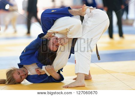 ST. PETERSBURG, RUSSIA - APRIL 16, 2016: Match Anna Dudenko (white) vs Elizaveta Stepanova, both of Russia, during the Junior European Judo Cup. 346 athletes participated in the competition