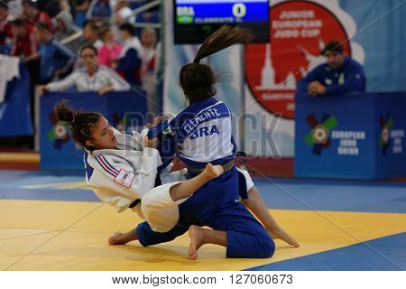 ST. PETERSBURG, RUSSIA - APRIL 16, 2016: Match Gabriela Clemente of Brazil (blue) vs Anais Mosdier of France during the Junior European Judo Cup. 346 athletes participated in the competition