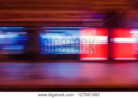 Motion blur of train driving fast forward representing business success