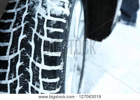 Winter tires in snow, closeup