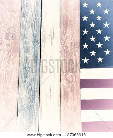 USA flag border on vertical rustic painted wooden boards in national colors of country. Vintage effect added to image.
