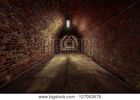 Long underground brick tunnel angle shot dark