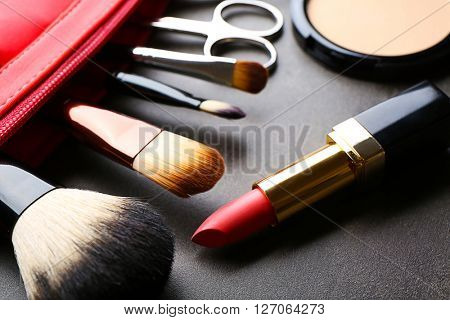Decorative makeup cosmetics and manicure tools on the table