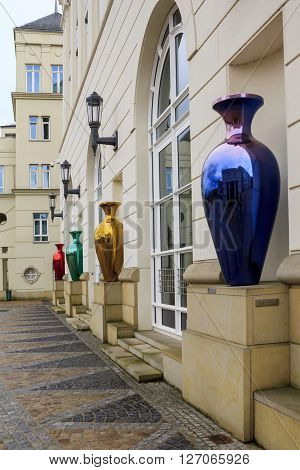Luxembourg, Luxembourg - May 15: These multicolored mirrored vases decorate the houses square to the Judicial City of Luxembourg May 15, 2013 in Luxembourg, Luxembourg.