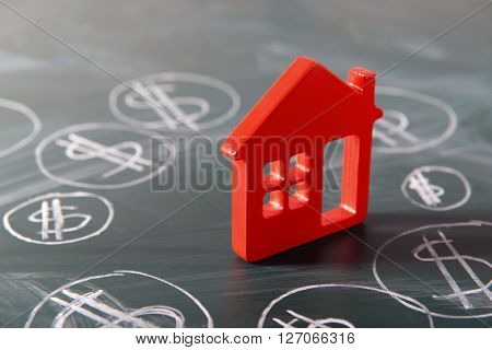 House figure and painted dollar symbols on chalkboard,closeup