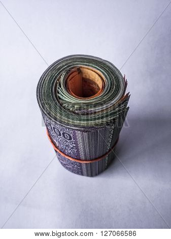 A shot of rolled up Malaysian currency tied with a rubber band.