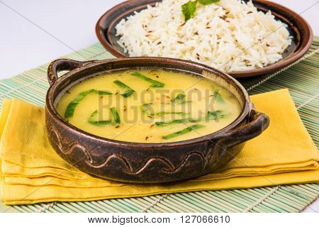 Whole Yellow Lentil with Rice, dal tadka and jeera rice, Indian Dish, cooked rice and cooked Arhar or Toor dal (Pigeon Pea), served in ceramic bowl