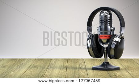 Microphone and headphones on wooden table - 3d render