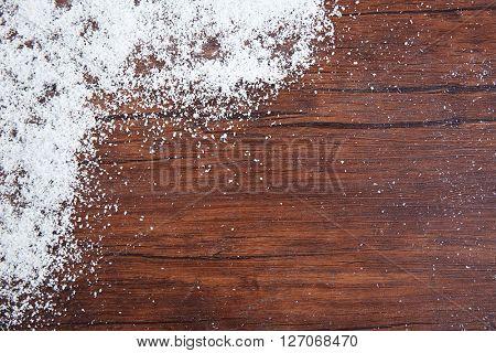 Snowy brown wooden background