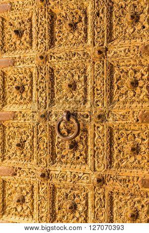 Golden door close up. Detail of Patwa Haveli in Jaisalmer, Rajasthan, India