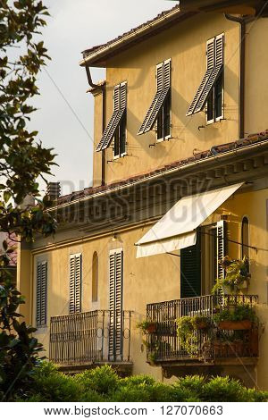 Traditional italian house in sunset light in Lucca, Italy.