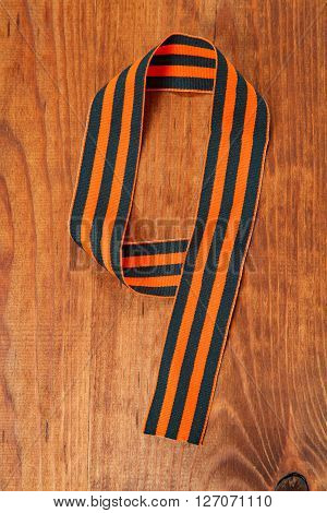 George's Ribbon On A Wooden Background In A Number 9