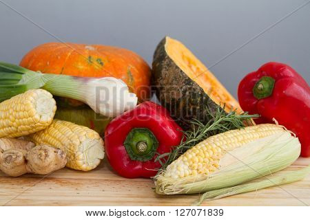 Organic Pumpkin Squash With Fresh Vegetables: Corn, Red Peppers, Scallion, Rosemary And Ginger