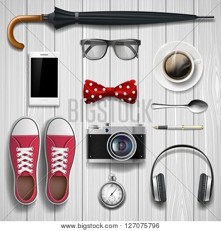 Set of items and accessories for the student and hipster. Lying on a wooden background. Stock vector illustration.