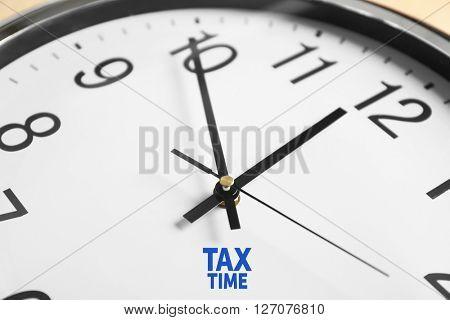 Tax Concept. Clock face closeup