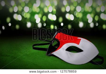 Masquerade masks with blur green light background