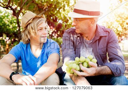 Father and son in vineyard