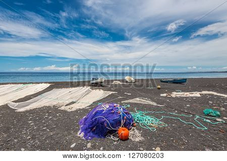 Fishing nets drying on the black beach on the island of La Reunion (France) in the Indian ocean.