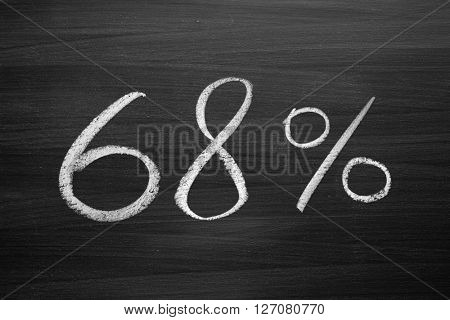68 percent header written with a chalk on the blackboard