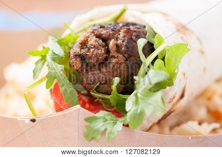lamb wrap with home made pita and sweet rice ** Note: Shallow depth of field