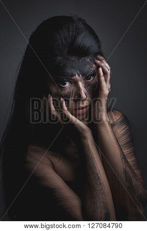 Spooky portrait of the woman. Demon theme on Halloween.