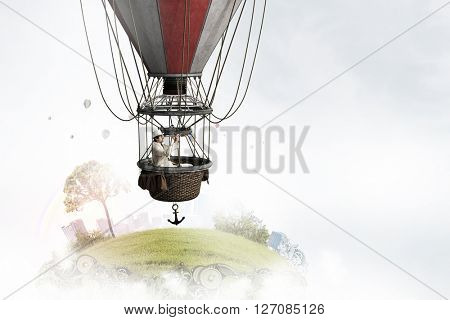 Elegant man traveling in aerostat