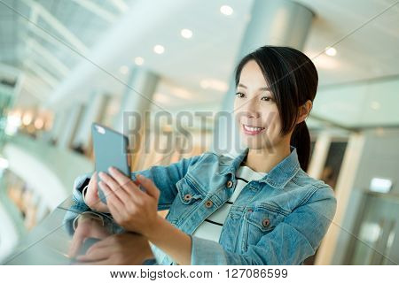 Woman read on mobile phone