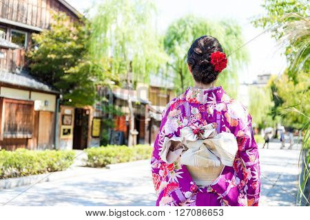The back view of woman with kimono dressing