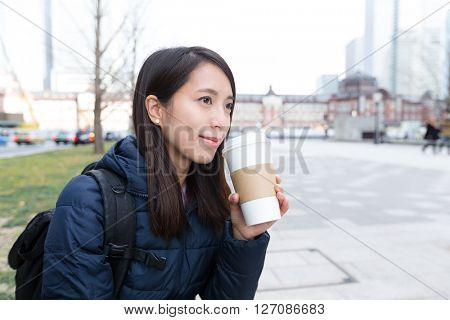Woman drink of coffee at outdoor
