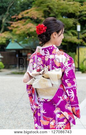 Back view of woman with kimono dressing
