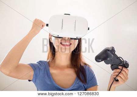 Young Woman play video game with virtual reality device