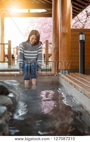 Woman enjoy her foot onsen