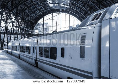 train cars on a modern train station