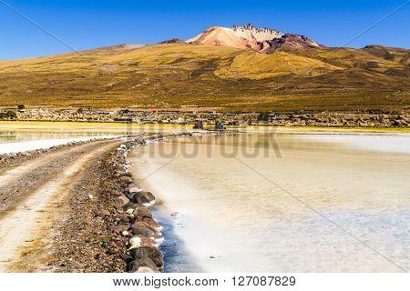 Dormant volcano and the salt lake at Solar De Uyuni Bolivia