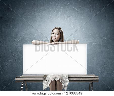 Girl showing banner