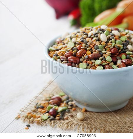 Mix of red  bean, lentil, green peas and chickpeas with vegetables over white