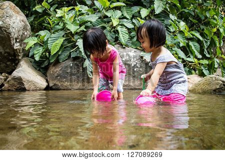 Asian Little Chinese Girls Playing In Creek