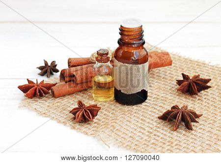 Cinnamon and anise star essential oils. Spicy aromatherapy.