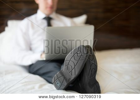 Businessman Using Laptop In Hotel. Close-up