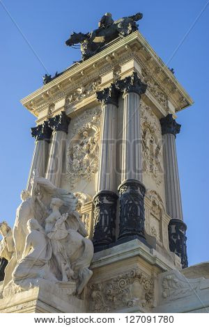Culture, Stone monument with Ionic columns in the Jardin del Retiro in Madrid, Spain