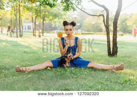 Bright Makeup Beautiful Girl With Yorkshire Terrier Seating On The Grass Holding Watermelon Lollipop