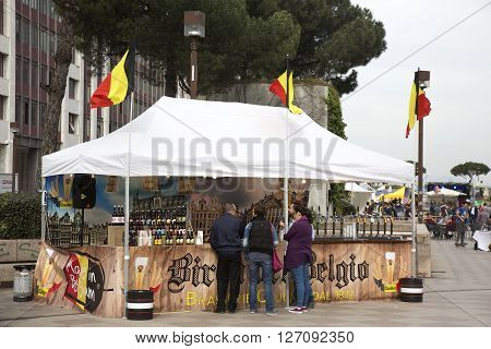 Naples Italy. April 21 2016: People tasting and buying Belgian beer during the International Street Food Parade in the Business Centre of Naples