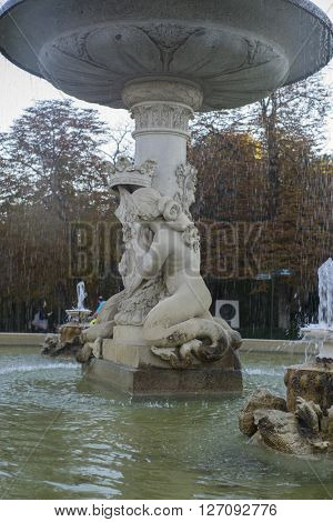 stone fountain with bronze figures in the Jardin del Retiro in Madrid, Spain