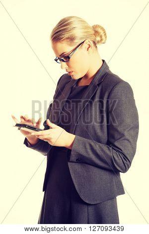 Businesswoman sending a message